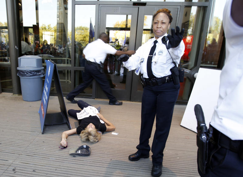 A demonstrator lies on the ground at an entrance to the National Air and Space Museum in Washington after police pepper-sprayed a group of protestors trying to get into the museum Saturday, Oct. 8,  2011, as part of Occupy DC activities in Washington. (AP Photo/Jose Luis Magana)