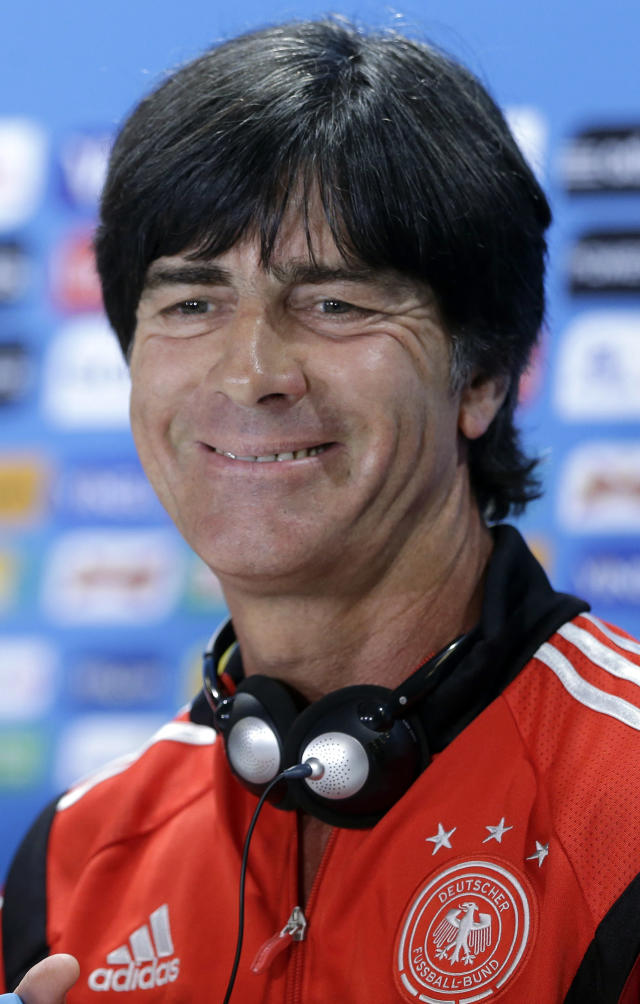 German national soccer team head coach Joachim Loew smiles during a news conference after an official training session one day before the World Cup semifinal soccer match between Brazil and Germany at the Mineirao Stadium in Belo Horizonte, Brazil, Monday, July 7, 2014. (AP Photo/Matthias Schrader)