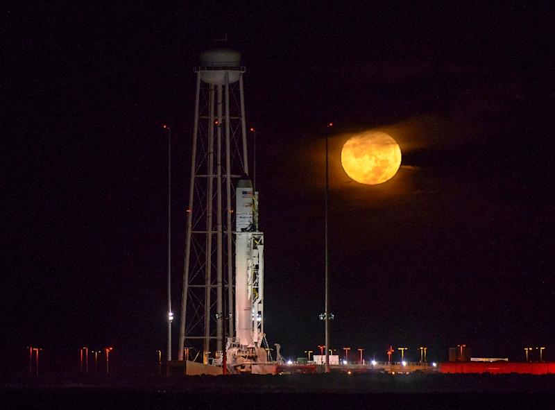 The Antares rocket emblazoned with an American flag lit up the night sky as it blasted off from Wallops Island, Virginia (AFP Photo/NASA/Bill Ingalls)