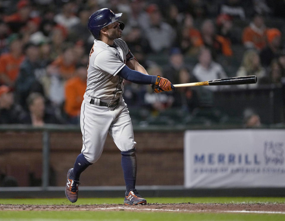 Houston Astros' Jose Altuve watches his grand slam against the San Francisco Giants during the sixth inning of a baseball game Friday, July 30, 2021, in San Francisco. (AP Photo/Tony Avelar)