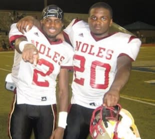 DeAntre Turman, on left, died after breaking his neck during a tackle in a scrimmage — Twitter