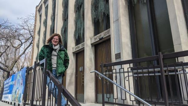 Morag MacRae stands outside Temple Emanu-El-Beth Sholom in Westmount, Que. (Submitted by Moritz Wittman - image credit)