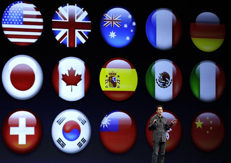 Scott Forstall, Apple's senior vice president of iOS Software, shows flags representing different languages for the new iOS 6 software, during the Apple Developers Conference in San Francisco, Monday, June 11, 2012. New iPhone and Mac software and updated Mac computers were among the highlights Monday at Apple Inc.'s annual conference for software developers. (AP Photo/Marcio Jose Sanchez)