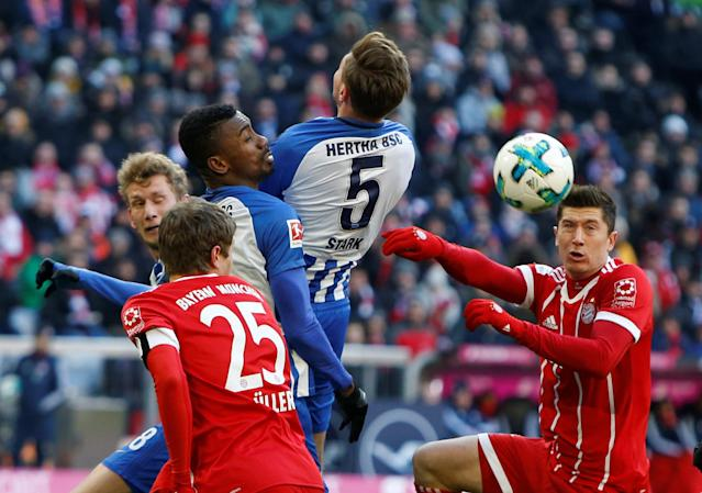Soccer Football - Bundesliga - Bayern Munich vs Hertha BSC - Allianz Arena, Munich, Germany - February 24, 2018 Hertha Berlin's Salomon Kalou and Niklas Stark in action with Bayern Munich's Thomas Muller and Robert Lewandowski REUTERS/Michaela Rehle DFL RULES TO LIMIT THE ONLINE USAGE DURING MATCH TIME TO 15 PICTURES PER GAME. IMAGE SEQUENCES TO SIMULATE VIDEO IS NOT ALLOWED AT ANY TIME. FOR FURTHER QUERIES PLEASE CONTACT DFL DIRECTLY AT + 49 69 650050