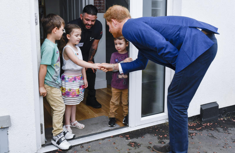 Lily-Anne and Prince Harry enjoying a conversation. (Pool via Getty Images)