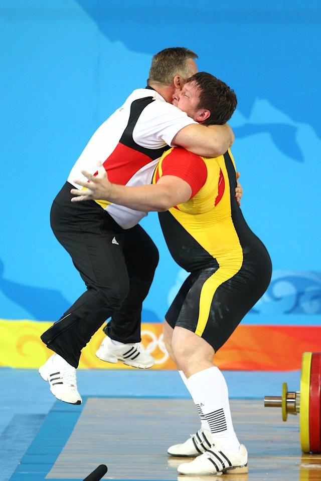 BEIJING - AUGUST 19: Matthias Steiner of Germany celebrates winning the gold medal in the Men's 105 kg group weightlifting event with his coach Frank Mantek at the Beijing University of Aeronautics & Astronautics Gymnasium on Day 11 of the Beijing 2008 Olympic Games on August 19, 2008 in Beijing, China. (Photo by Julian Finney/Getty Images)