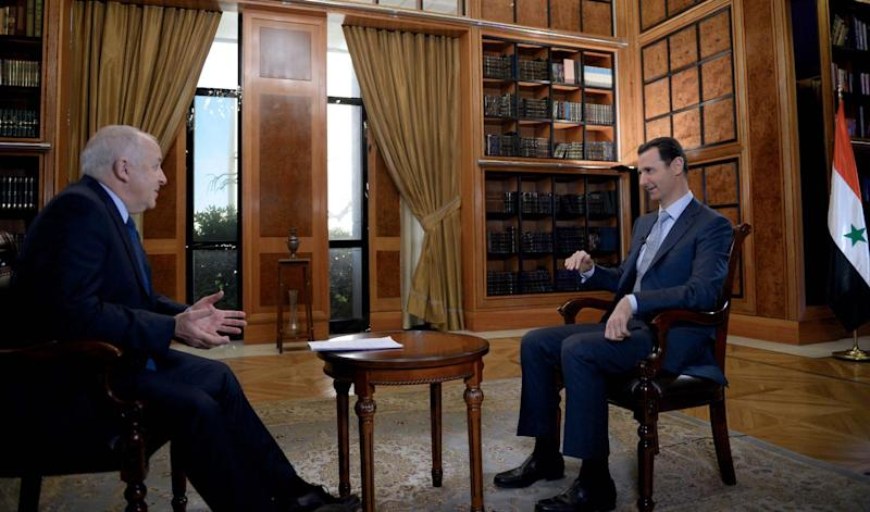 A picture dated February 8, 2015, and released by the Syrian Arab News Agency on February 10, 2015 shows President Bashar al-Assad (R) giving an interview to the BBC's Jeremy Bowen in Damascus (AFP Photo/)