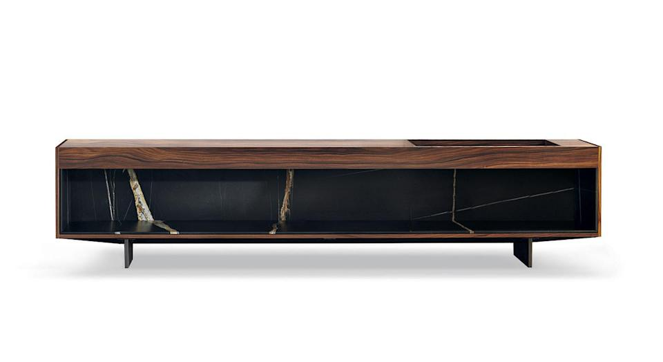 """<p>Although made in Italy, Minotti's latest collection is a global affair, calling on designers and influences from as far afield as Japan, Denmark and Brazil. Studio MK27, the São Paulo-based practice headed up by Marcio Kogan, has created the 'Boteco' (which means bar in English) family of sideboards and coffee tables. Playing with layers of materials, the sideboards marry dark-stained oak with seductive Sahara Noir marble. From £19,794, <a href=""""https://www.minotti.com/en"""" rel=""""nofollow noopener"""" target=""""_blank"""" data-ylk=""""slk:minotti.com"""" class=""""link rapid-noclick-resp"""">minotti.com</a></p>"""