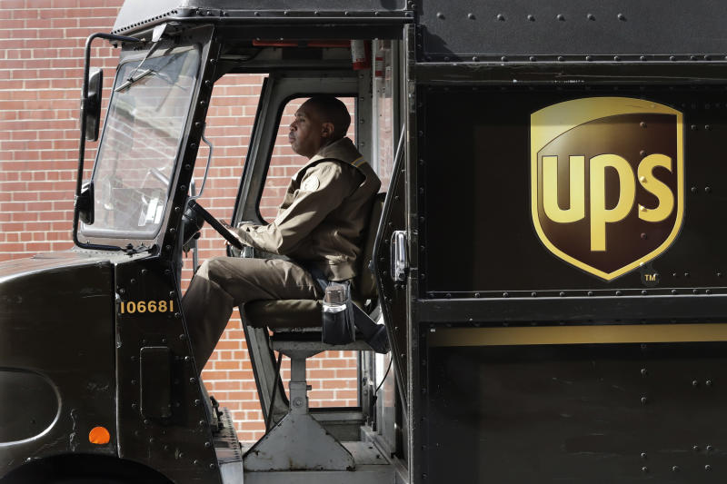 FILE - In this Tuesday, May 9, 2017 file photo, a UPS driver takes his truck on a delivery route in New York. After UPS contract vote, Teamsters drivers feel betrayed. Tens of thousands of Teamsters members earlier this month voted down a five-year contract proposal from United Parcel Service. But less than half of the eligible union members voted, triggering a Teamster rule that allowed the contract to be ratified anyway. Now, many Teamsters members are angry, confused and feel like their union leadership has betrayed them. (AP Photo/Mark Lennihan, File)