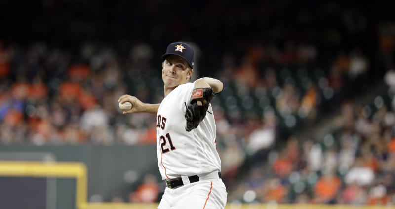 Houston Astros' starting pitcher Zack Greinke (21) throws against the Oakland Athletics during the first inning of a baseball game Monday, Sept. 9, 2019, in Houston. (AP Photo/David J. Phillip)