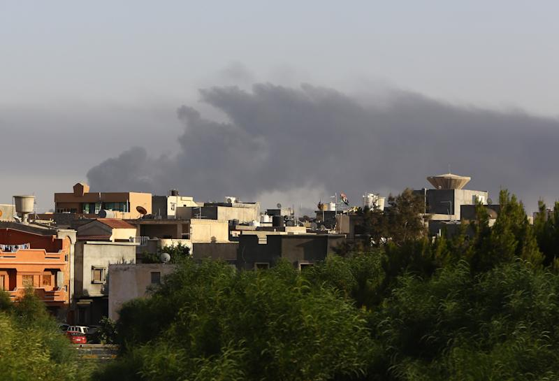 Smoke billows from an area near Tripoli's international airport as fighting between rival factions continues, July 24, 2014 (AFP Photo/Mahmud Turkia)