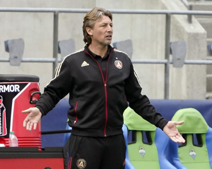 FILE - In this May 23, 2021, file photo, Atlanta United head coach Gabriel Heinze gestures from the bench during the second half of an MLS soccer match against the Seattle Sounders in Seattle. Atlanta United's disappointing 2021 record has cost Heinze his job. Atlanta United fired Heinze on Sunday, July 18, 2021. (AP Photo/Ted S. Warren, File)
