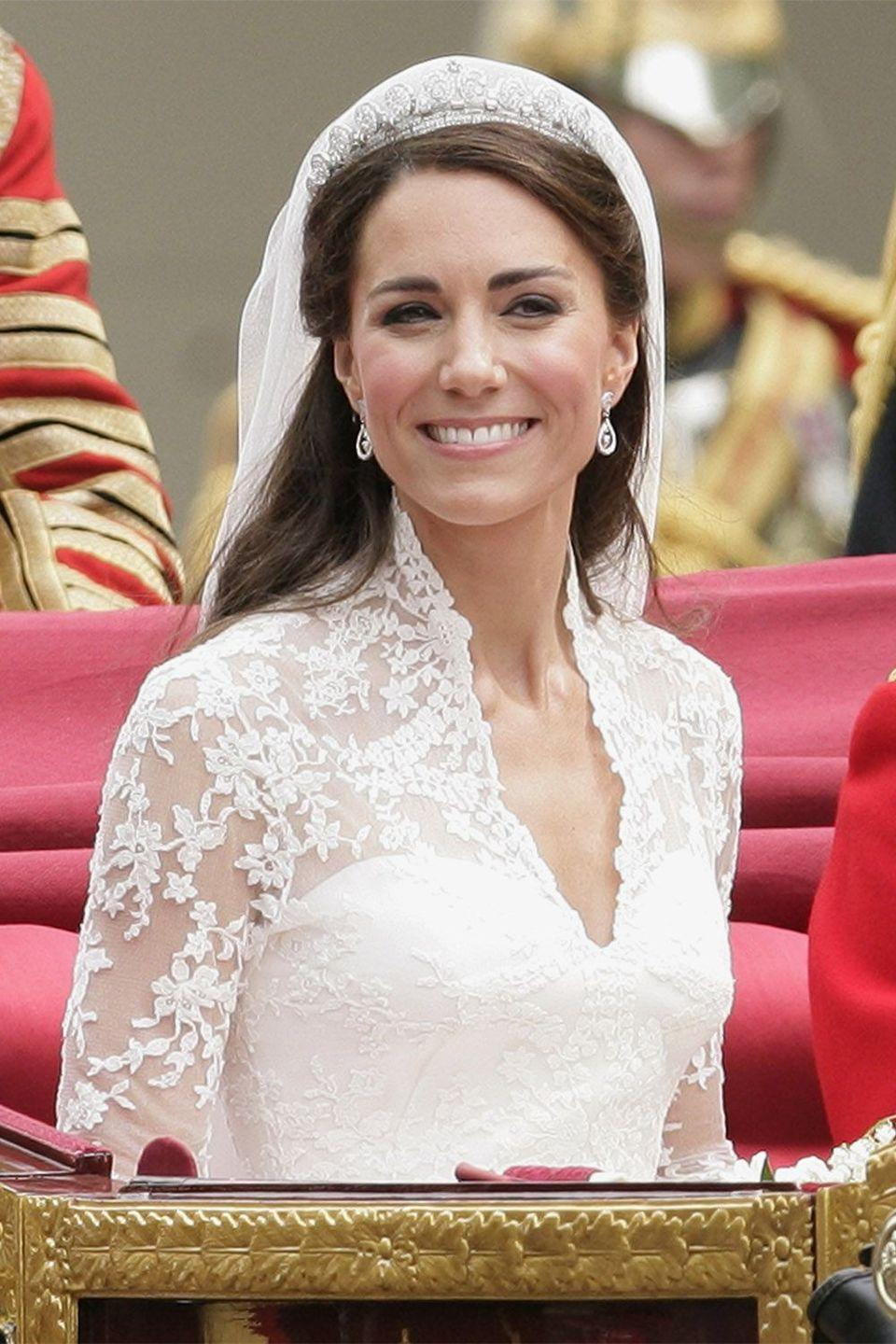 <p>The Duchess of Cambridge chose a half-up style for her wedding hair</p>