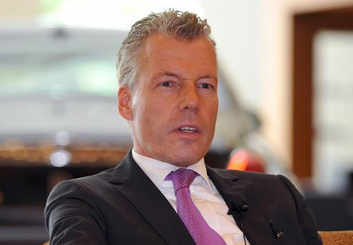 <p>Rolls-Royce Cars chief executive Torsten Muller-Otvos speaks to journalists in Singapore on October 8, 2013</p>