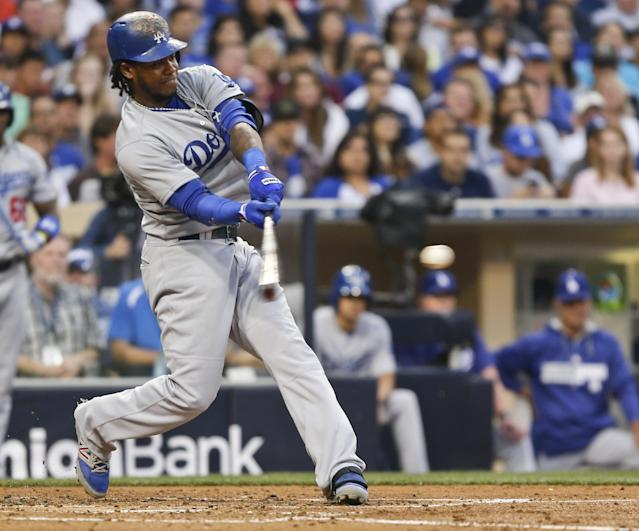 Los Angeles Dodgers' Hanley Ramirez hits a sacrifice fly that scored Dee Gordon from third base during the third inning of a baseball game Saturday, June 21, 2014, in San Diego. (AP Photo/Lenny Ignelzi)