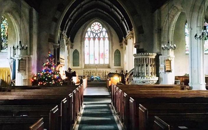 The 32 Victorian pewsinside of Grade II listed St Andrew's Church in the Dorset village of Okeford Fitzpaine - BNPS