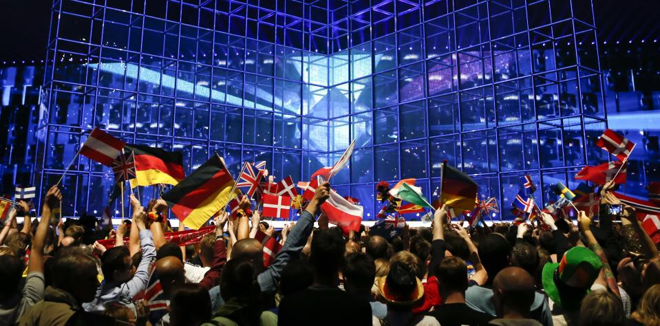 Flags are waved ahead of the final of the Eurovision Song Contest in the B&W Halls in Copenhagen, Denmark, Saturday, May 10, 2014. (AP Photo/Frank Augstein)