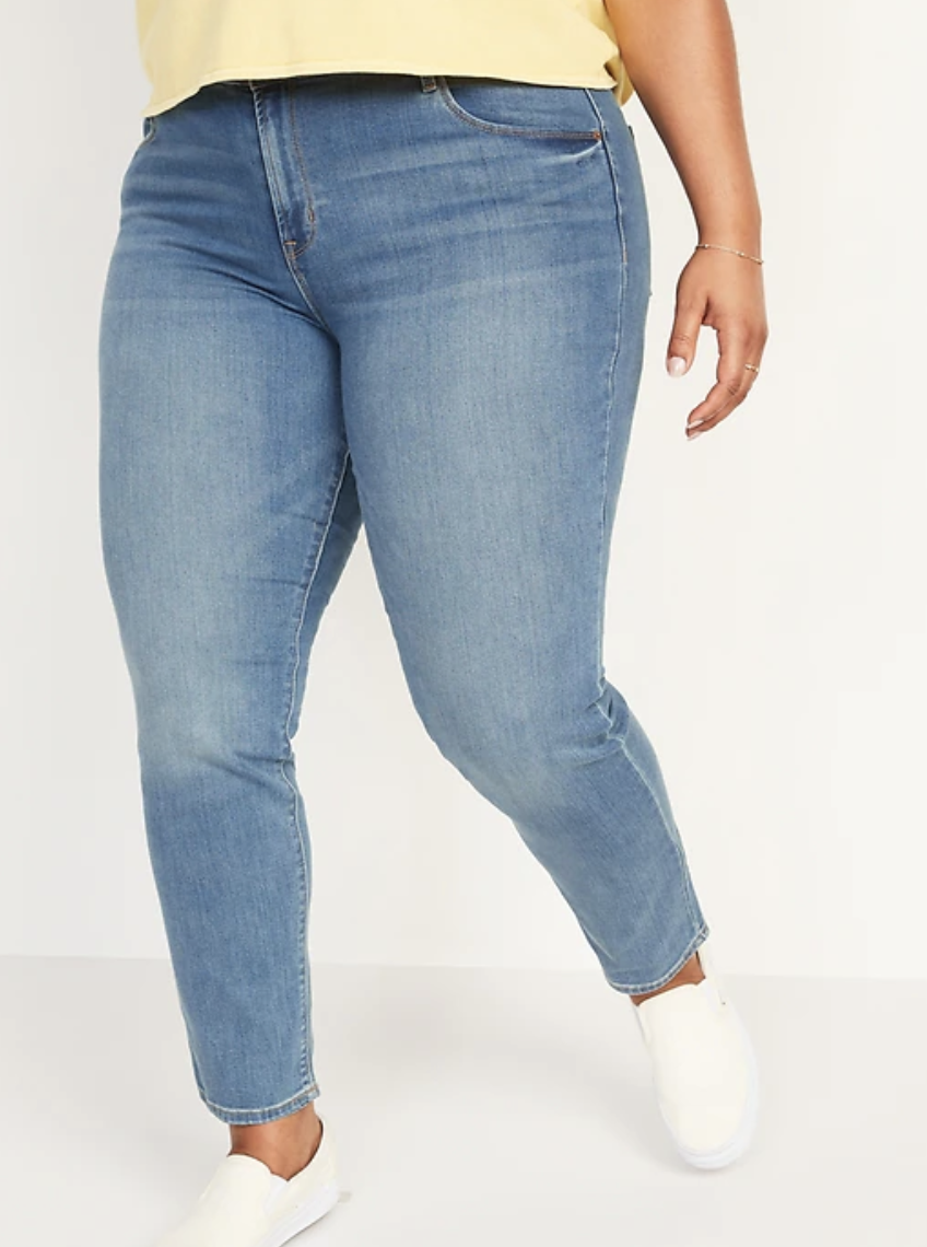plus size model wearing blue Mid-Rise Power Slim Straight Jeans