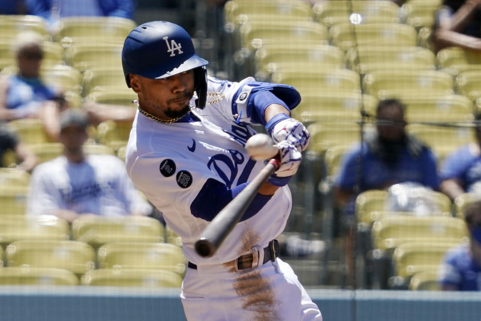 Los Angeles Dodgers' Mookie Betts hits a solo home run during the third inning of a baseball game against the Texas Rangers Sunday, June 13, 2021, in Los Angeles. (AP Photo/Mark J. Terrill)