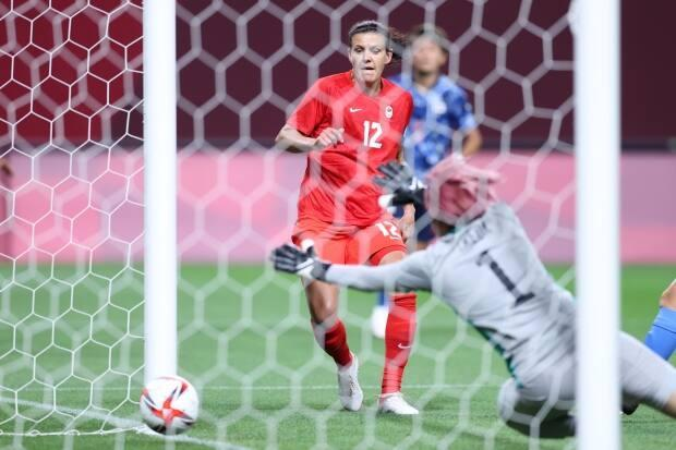 Christine Sinclair scores the first goal for Team Canada during the first-round match between Japan and Canada during the Tokyo 2020 Olympic Games at Sapporo Dome on Wednesday in Sapporo, Japan. (Masashi Hara/Getty Images - image credit)