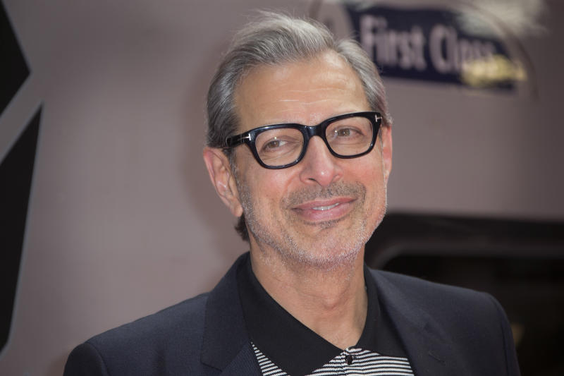 """FILE - In this June 6, 2016, file photo, actor Jeff Goldblum poses for photographers at the photo call for the film Independence Day Resurgence at Euston Station in London. The Hollywood Reporter said on April 25, 2017 that Goldblum would return to the Jurassic Park franchise for the upcoming sequel to 2015's """"Jurassic World."""" (Photo by Joel Ryan/Invision/AP, File)"""