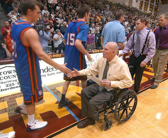 FILE - In a Saturday, Jan. 10, 2009 file photo, Northern State University Men's Basketball Coach, Don Meyer, shakes hands with a University of Mary player after he got his 903rd win, passing Bobby Knight as the NCAA's winningest coach in men's basketball history, in Aberdeen, S.D. Meyer, one of the winningest coaches in college basketball who came back from a near-fatal car accident and liver cancer before closing out his career, has died in South Dakota. He was 69. (AP Photo/Doug Dreyer, File)