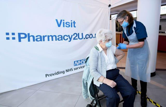 A vaccine is administered at the Odeon Cinema in Aylesbury (Jonathan Hordie/AP)