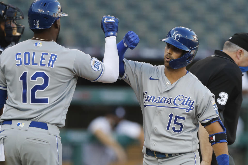 Kansas City Royals' Whit Merrifield(15) is greeted by Jorge Soler after hitting a three-run home run during the third inning of a baseball game against the Detroit Tigers, Tuesday, July 28, 2020, in Detroit. (AP Photo/Carlos Osorio)