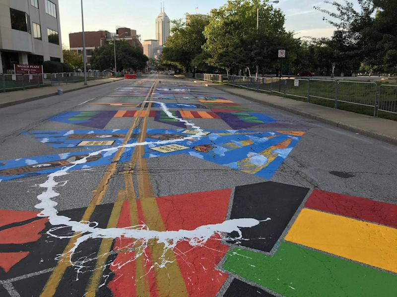 White or gray paint splashed over the Black Lives Matter mural on Indiana Avenue is visible Sunday morning, Aug. 9, 2020. The mural was finished for less than a week before being defaced Saturday night or Sunday morning.