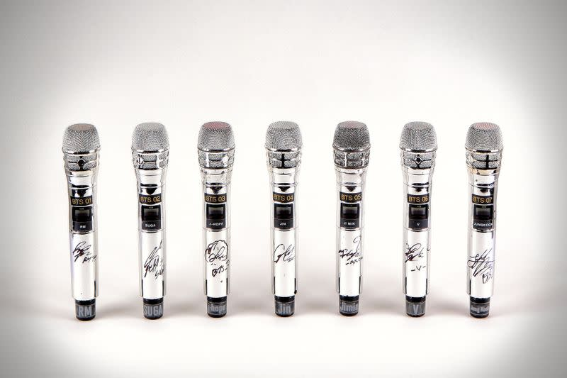 Seven signed microphones used by K-Pop boy band BTS, described as the first ever items to come to auction from the band, are seen in an undated photo before an auction online in Los Angeles