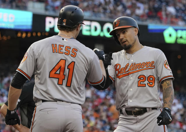 Baltimore Orioles' Jace Peterson (29) celebrates a two-run home run with David Hess (41) during the third inning of the team's baseball game against the Washington Nationals at Nationals Park, Tuesday, June 19, 2018, in Washington. (AP Photo/Carolyn Kaster)