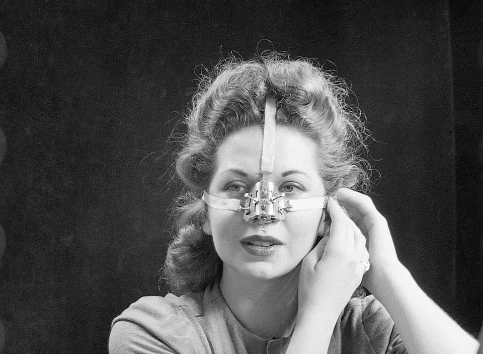 <p>It may appear that this woman is wearing a brace to fix a broken nose, but she's actually wearing a $6 nose shaper that allegedly contoured the nose. Over 100,000 units were sold in 1944.</p>