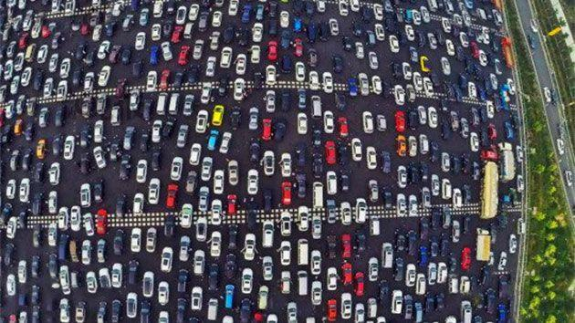 And amazing footage show several hundreds of thousands of drivers slowly making their way home on the penultimate day of the holiday. Photo: CEN/Yahoo UK