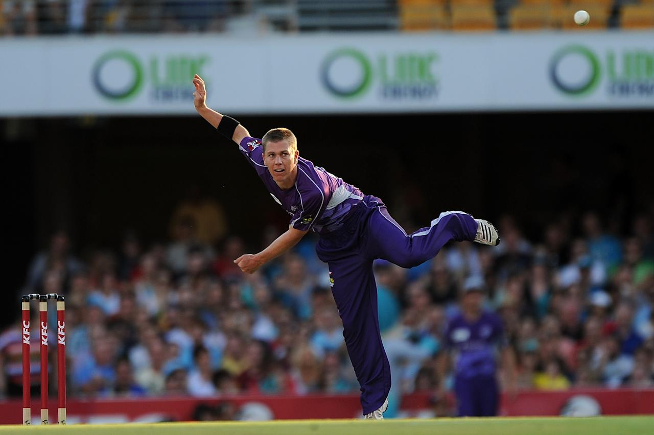 BRISBANE, AUSTRALIA - DECEMBER 09:  Xavier Doherty of the Hurricanes bowls during the Big Bash League match between the Brisbane Heat and the Hobart Hurricanes at The Gabba on December 9, 2012 in Brisbane, Australia.  (Photo by Matt Roberts/Getty Images)