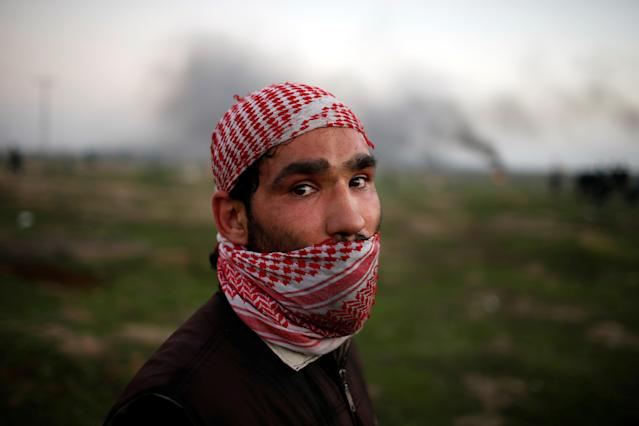 """<p>A Palestinian protester poses for a photograph at the scene of clashes with Israeli troops near the border with Israel, east of Gaza City, Jan. 12, 2018. """"As a young man, I feel very oppressed and deprived of a dignified life so the only thing I can do is to revolt against the thing behind this suffering – the Israeli occupation. The occupation seized our homeland with the support of America which now recognises Jerusalem as Israel's capital,"""" he said. (Photo: Mohammed Salem/Reuters) </p>"""