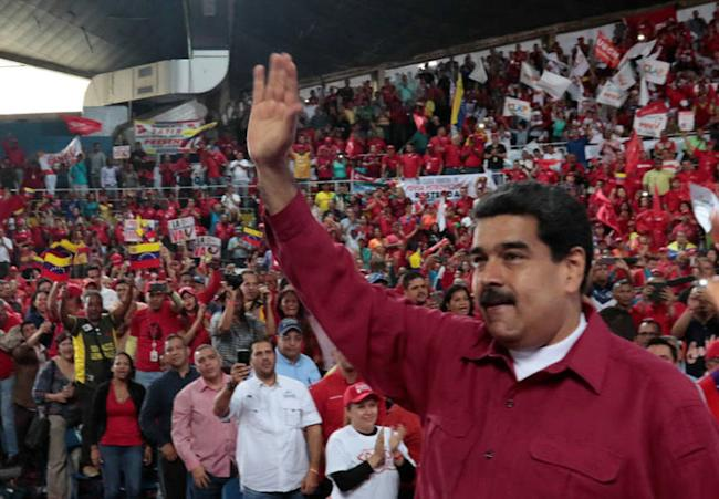 Venezuela's President Nicolas Maduro waves during a pro-government rally with workers of state-run oil company PDVSA, in Barcelona, Venezuela July 8, 2017. Miraflores Palace/Handout via REUTERS
