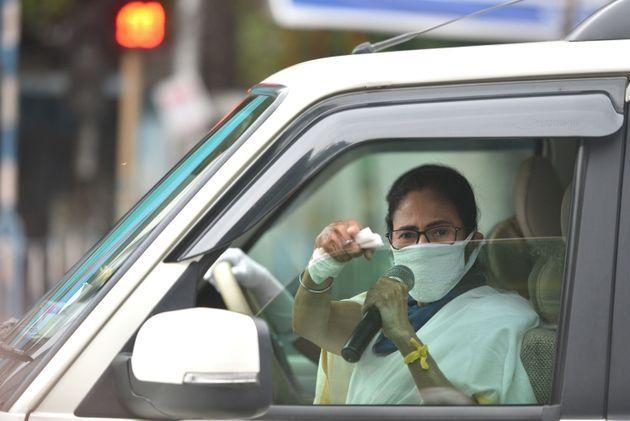 Chief minister of West Bengal Mamata Banerjee directs people for proper adherence of social distancing, during lockdown to curb the spread of coronavirus, at Moulali crossing in Kolkata on April 23, 2020.