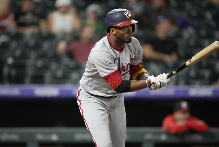 Washington Nationals' Alcides Escobar singles against Colorado Rockies starting pitcher German Marquez in the fifth inning of a baseball game Monday, Sept. 27, 2021, in Denver. (AP Photo/David Zalubowski)