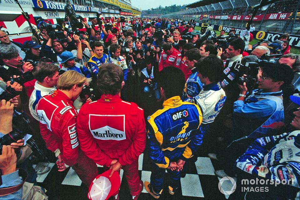 """The drivers stand on the grid, in remembrance a year after the deaths of Ayrton Senna and Roland Ratzenberger<span class=""""copyright"""">Motorsport Images</span>"""