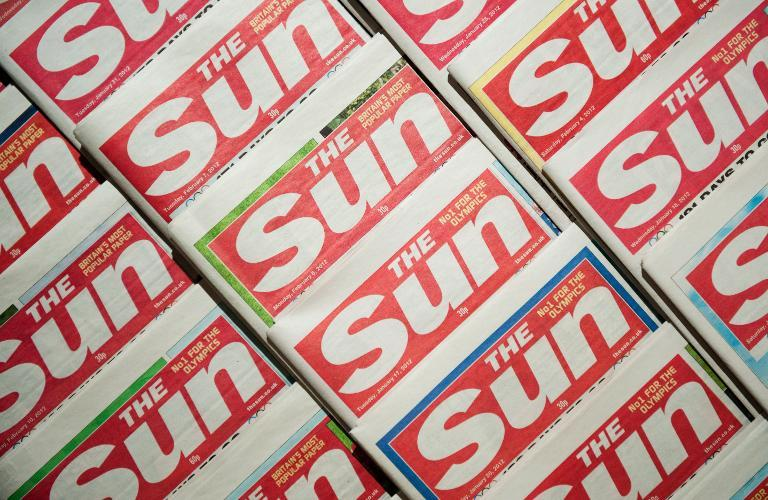 British tabloid The Sun has published a photo of a winking topless model, shooting down reports it had ended the controversial tradition that has featured in the newspaper since 1970 (AFP Photo/Leon Neal)