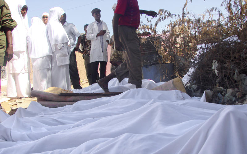 In this photo taken Wednesday, Dec. 19, 2012 and made available Friday, Dec. 21, 2012, the bodies of some of those who drowned in a boat sinking late Tuesday night are laid covered in white sheets in the town of Bosasso, Somalia. The U.N. refugee agency says 55 people have drowned or are missing after an overcrowded boat capsized off the Somali coast late Tuesday, representing the biggest loss of life in the Gulf of Aden since February 2011, when 57 Somali refugees and migrants drowned while attempting to reach Yemen. (AP Photo)