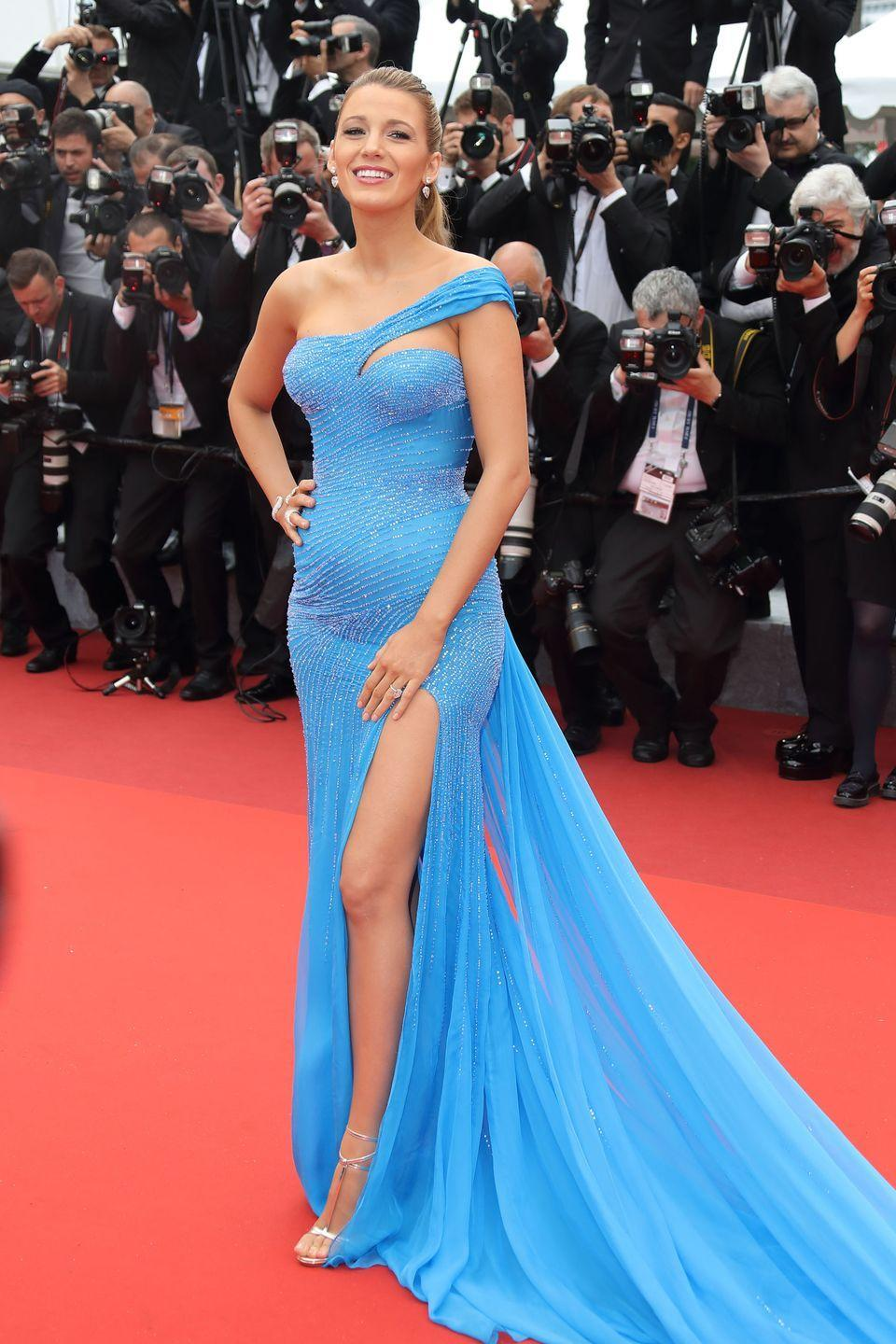 <p>Blake Lively channeled Queen Elsa at the<em> BFG</em> screening at the Cannes Film Festival in 2016 wearing a blue Versace dress with a train.</p>