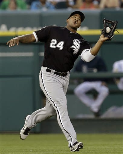 Chicago White Sox left fielder Dayan Viciedo catches a Detroit Tigers' Alex Avila fly ball in the third inning of a baseball game in Detroit, Friday, Aug. 31, 2012. (AP Photo/Paul Sancya)