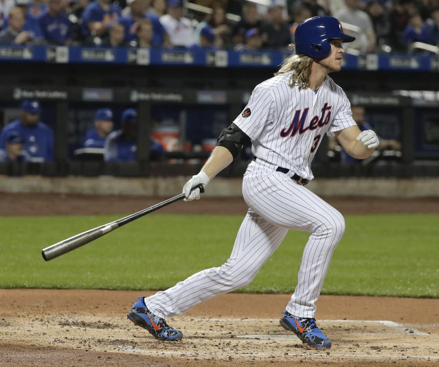 New York Mets' Noah Syndergaard (34) doubles to right field to drive in a run against the Toronto Blue Jays during the second inning of a baseball game, Tuesday, May 15, 2018, in New York. (AP Photo/Julie Jacobson)