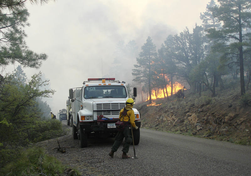 Firefighters work an area along the northwest perimeter of a massive blaze in the Gila National Forest in New Mexico in this photo made on Monday, May 28, 2012, and provided by the U.S. Forest Service Friday. More than 1,200 firefighters are battling the fire that has burned nearly 217,000 acres in an isolated mountainous area of southwestern New Mexico. (AP Photo/U.S. Forest Service, John Roads)