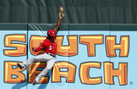 Washington Nationals center fielder Michael A. Taylor leaps at the wall to catch a fly ball by Miami Marlins' Derek Dietrich to end the third inning of an exhibition spring training baseball game, Wednesday, Feb. 28, 2018, in Jupiter, Fla. (AP Photo/Jeff Roberson)