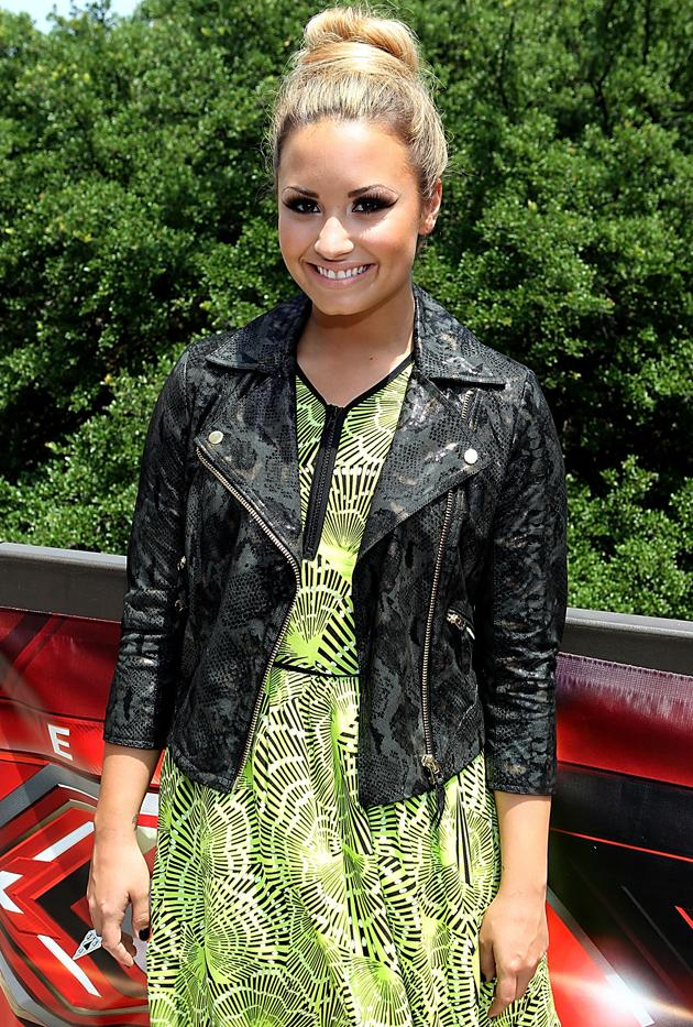 "One hairdo we've seen Lovato hit the red carpet with several times this year is the top knot – as seen here at an ""X Factor"" auditions in May. ""I like top knots because they are easy to create and they add a sophistication to an outfit,"" Lovato says. ""When I was younger, I never experimented with hairstyles. I always wore my hair down. At any event or any red carpet, my hair was down. Now that I'm finally getting confident to experiment, I'm loving putting it up and just trying new things."""