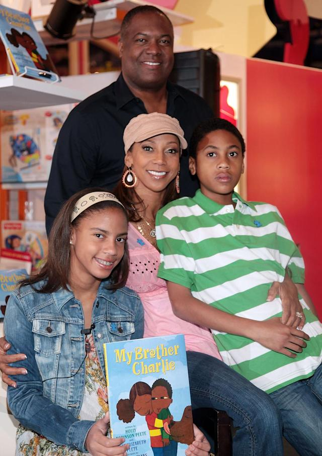 "Ryan Elizabeth Peete, Holly Robinson Peete, Rodney Peete, and Rodney Jackson ""R.J."" Peete promote ""My Brother Charlie"" and ""Not My Boy"" at Toys ""R"" Us on April 3, 2010, in New York City. (Photo by Astrid Stawiarz/Getty Images)"