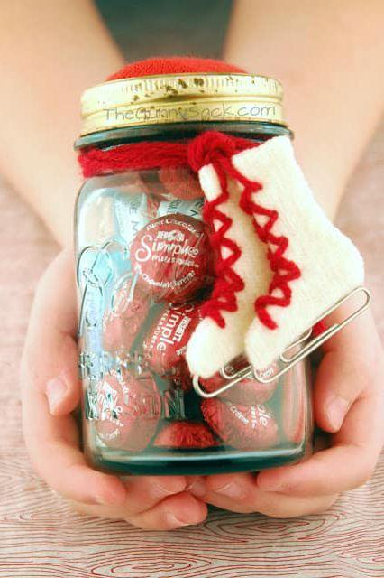 """<p>Fill a mason jar with gloves, hot chocolate mix, lip balm, and chocolate, and present it to a loved one as an """"Ice Skating Date"""" in a jar.</p><p><strong>Get the tutorial at <a href=""""http://www.thegunnysack.com/2013/01/ice-skating-date-in-jar-diy-valentines.html"""" rel=""""nofollow noopener"""" target=""""_blank"""" data-ylk=""""slk:The Gunny Sack"""" class=""""link rapid-noclick-resp"""">The Gunny Sack</a>.</strong></p>"""