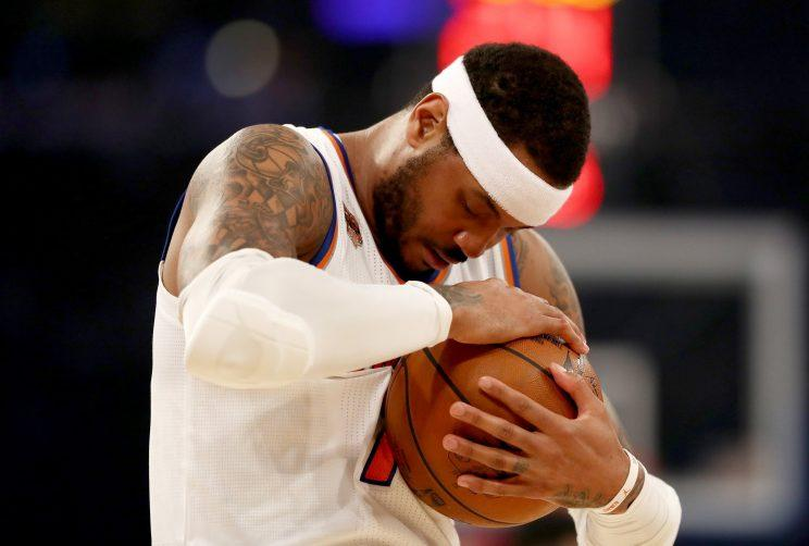 Carmelo Anthony tries to gaze upon his future, only to realize this isn't that kind of ball. (Getty)